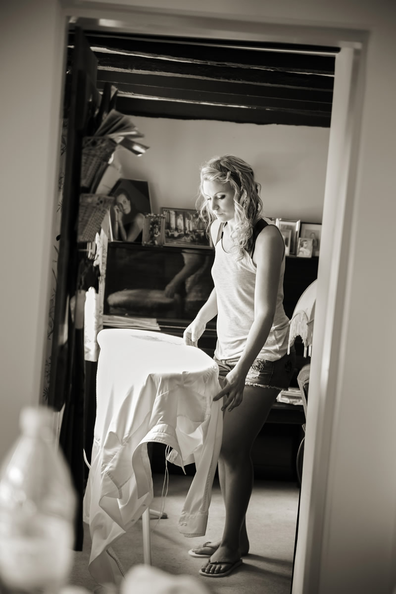 a bridesmaid ironing her dress
