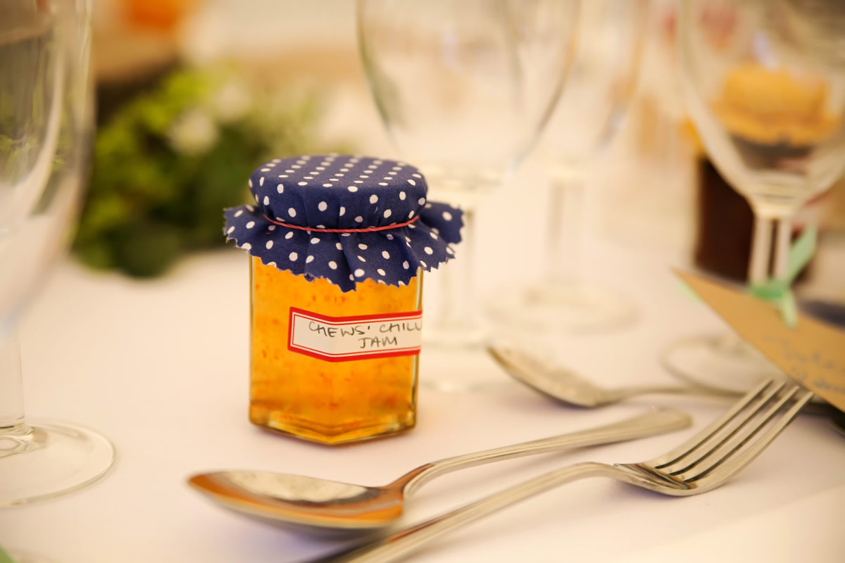 home made jam favours on a table at a wedding
