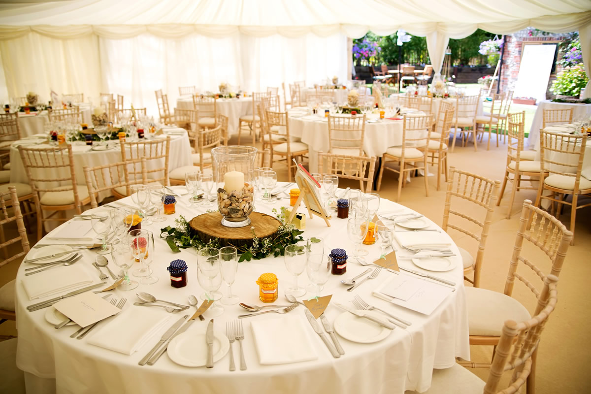 tables set up at a wedding in a marquee