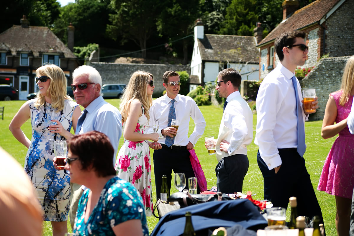wedding guests outside the Tiger Inn in East Dean