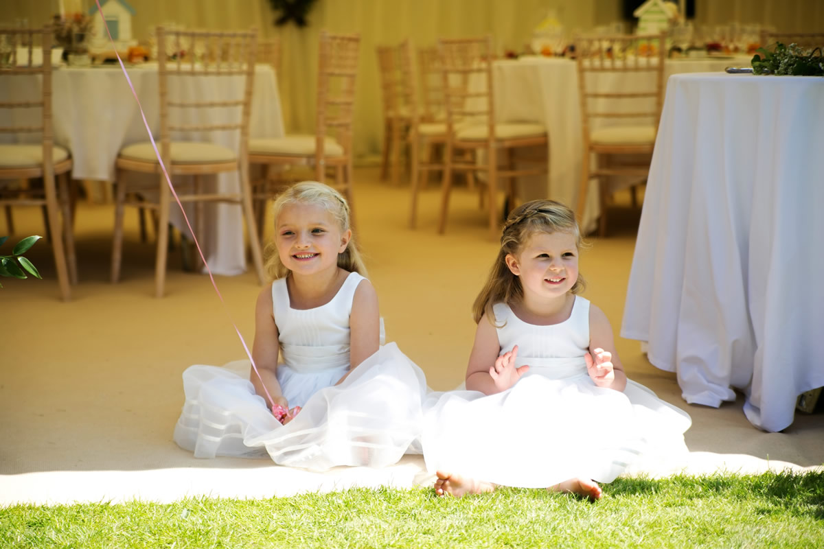two flower girls relaxing in the shade
