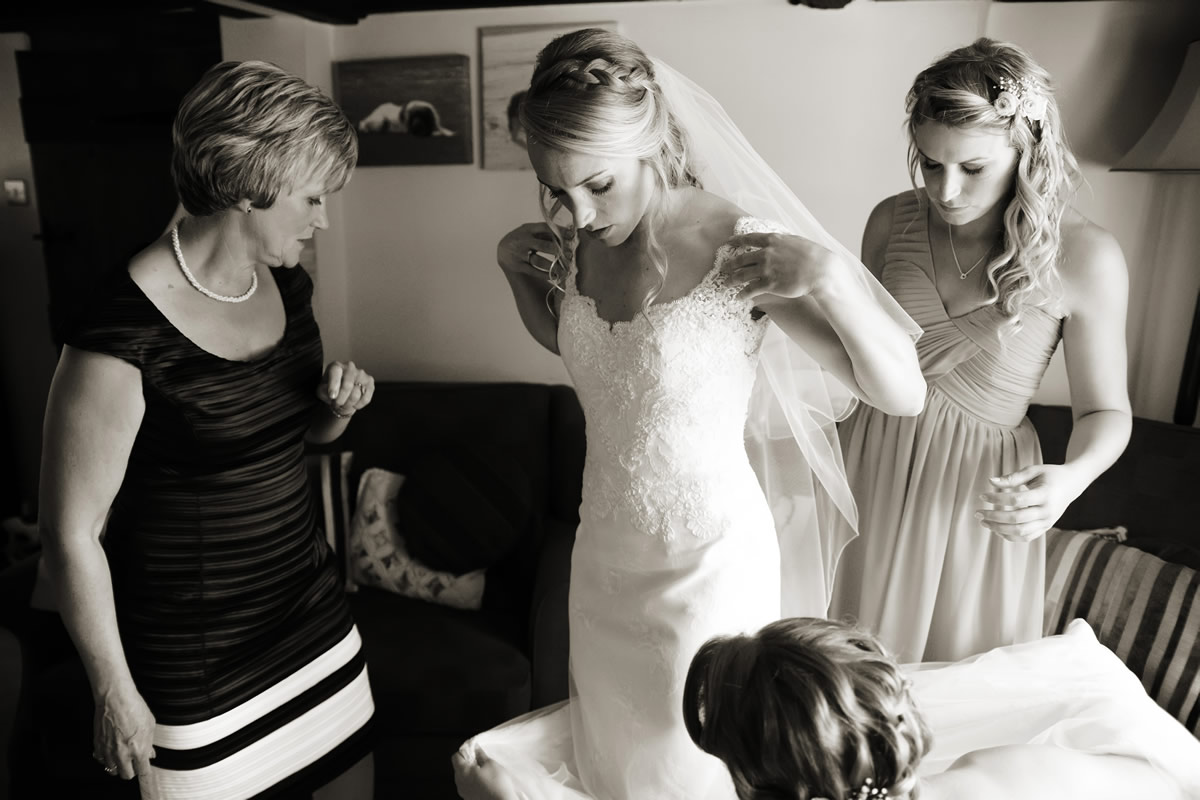 the bride putting on her dress