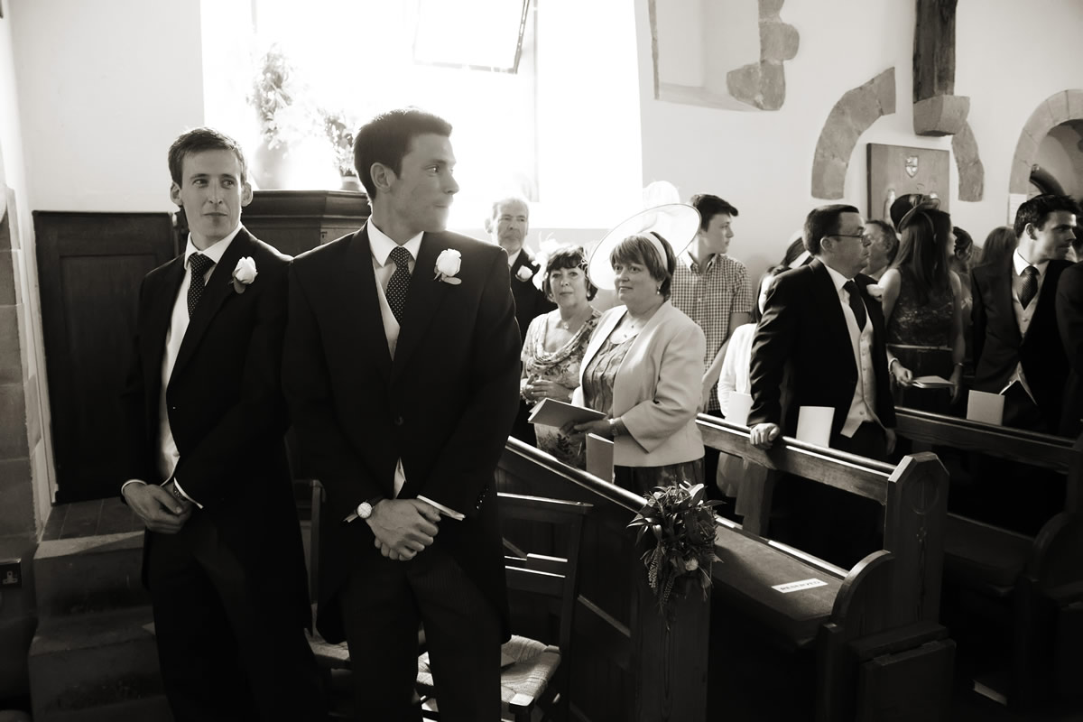 the groom waiting for his bride in the church