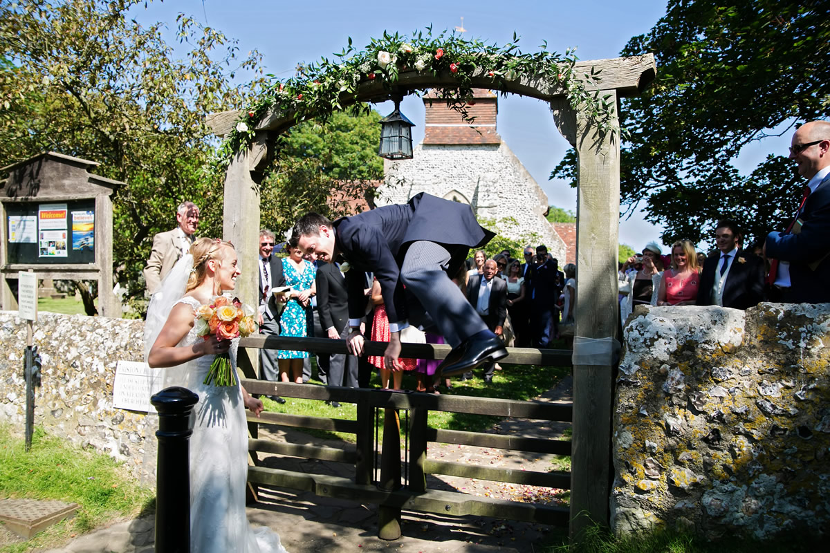 the groom jumping the church gate