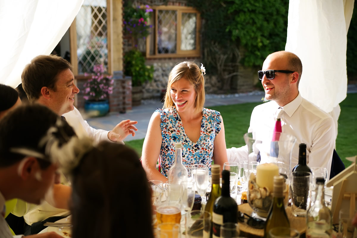guests enjoying the sun at a West Sussex wedding