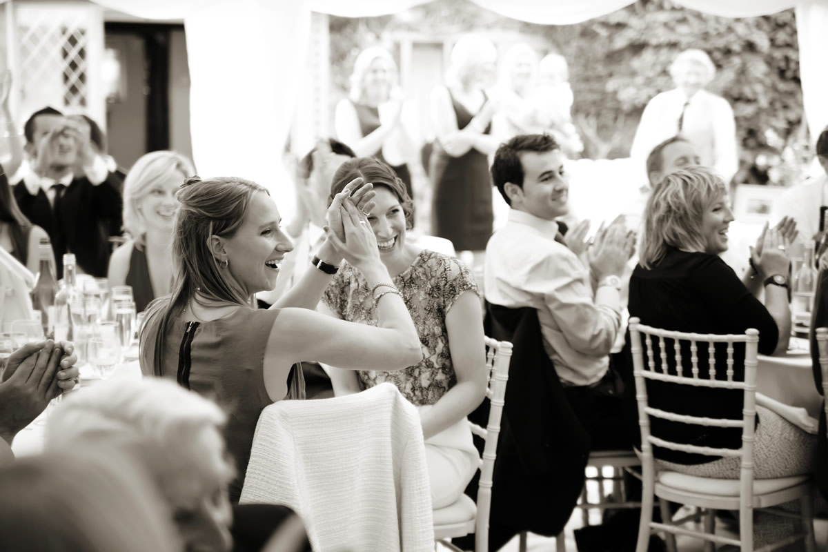 guests clapping the father of the bride's speech