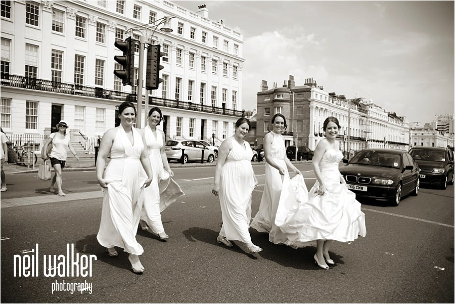 Bride Bridesmaids walking along Brighton seafront Black & White