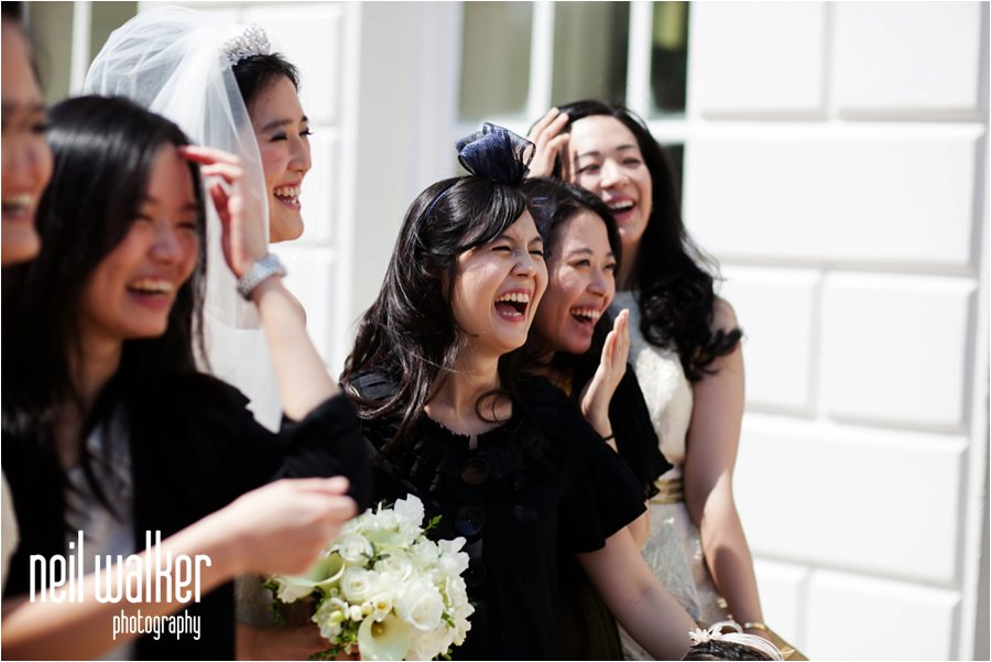 Guests laughing at a wedding at the Queen's House