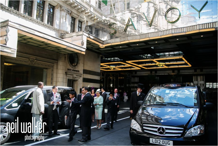 The front of the Savoy Hotel with a groom getting ready for his wedding