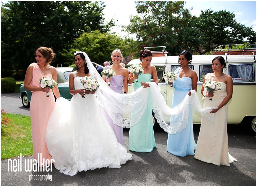 a bride with her bridesmaids outside church