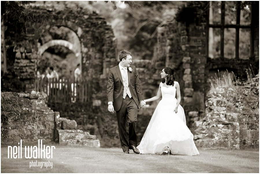 a bride & groom walking
