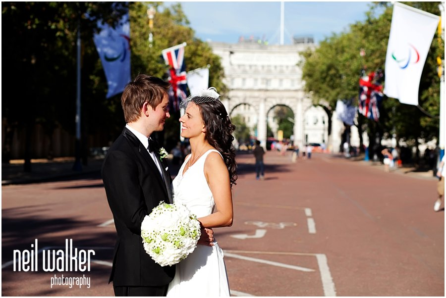 A bride & groom at a London wedding on The Mall