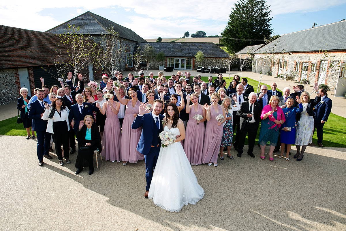 A big group shot of a wedding at Farbridge
