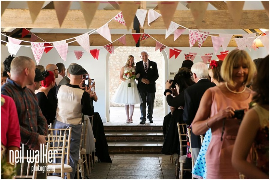 bride entering the ceremony in Sussex