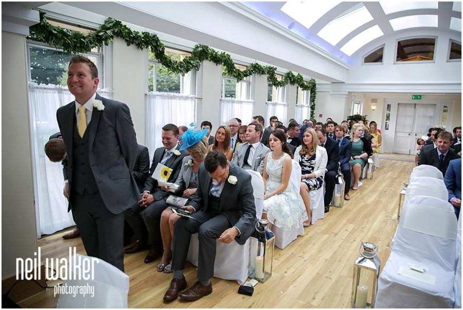 A groom waiting for his bride inside Pembroke Lodge's Belvedere room