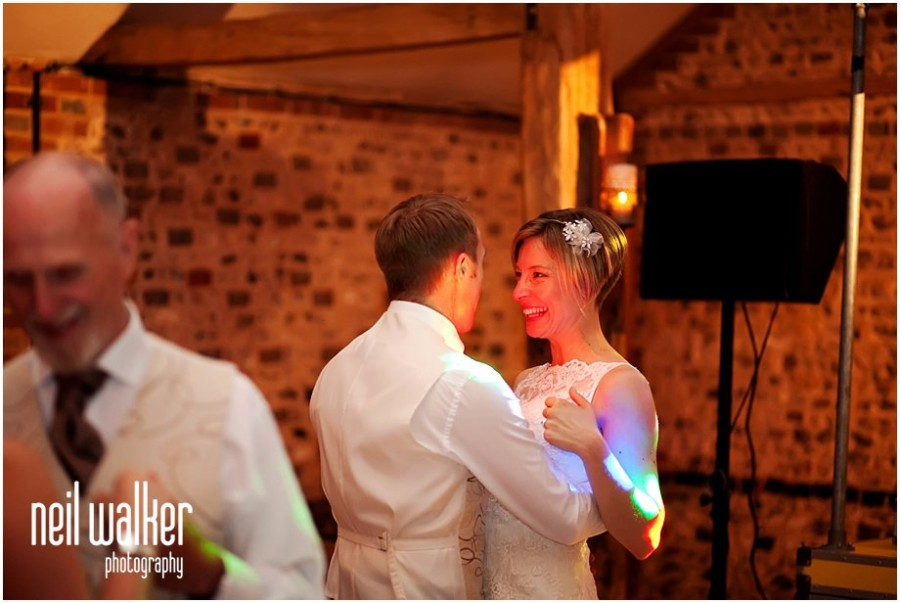 A bride & groom dancing at a wedding at Upwaltham Barns in Sussex