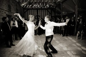 a bride & groom doing their first dance at Upwaltham Barns