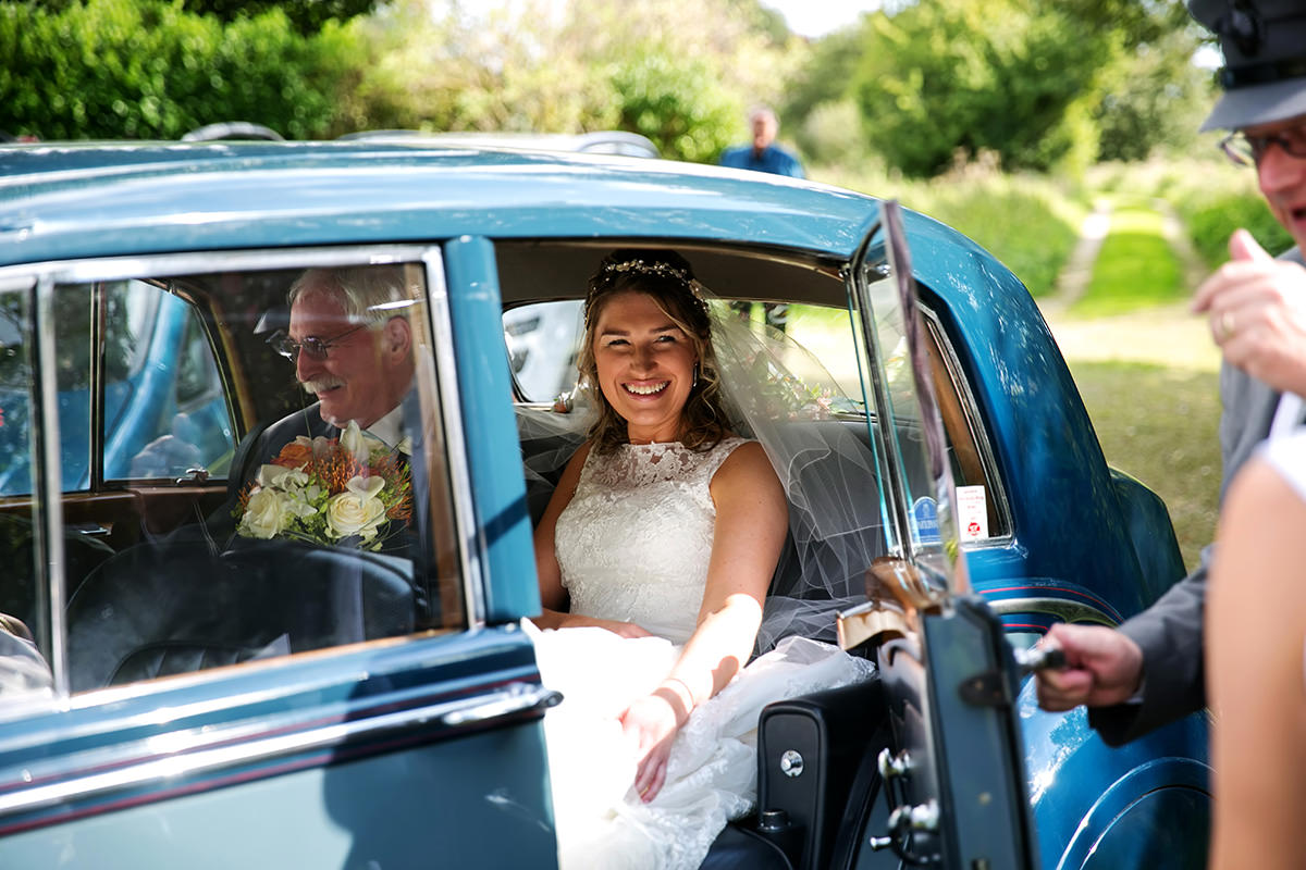 a bride arriving at her wedding at Farbridge