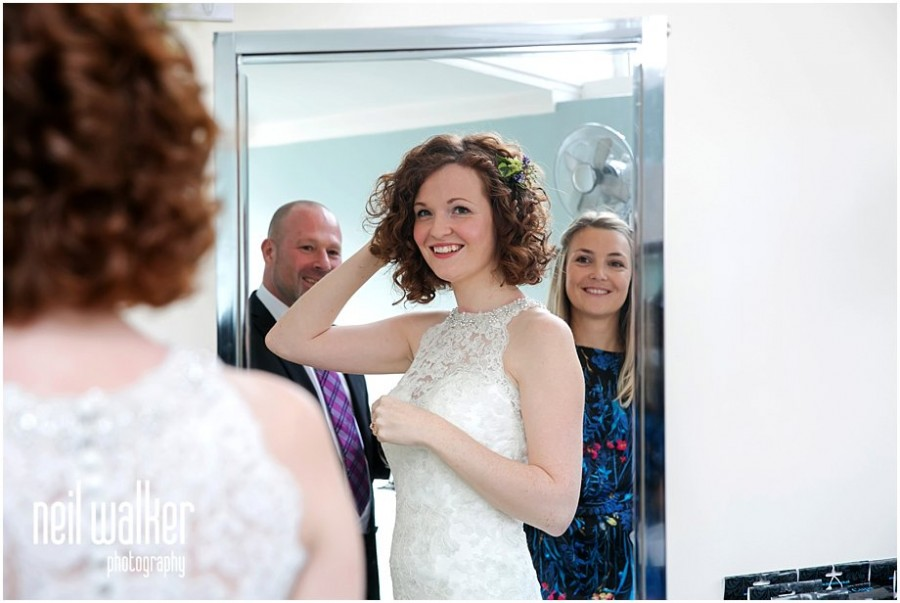 the bride & her bridesmaid in the mirror