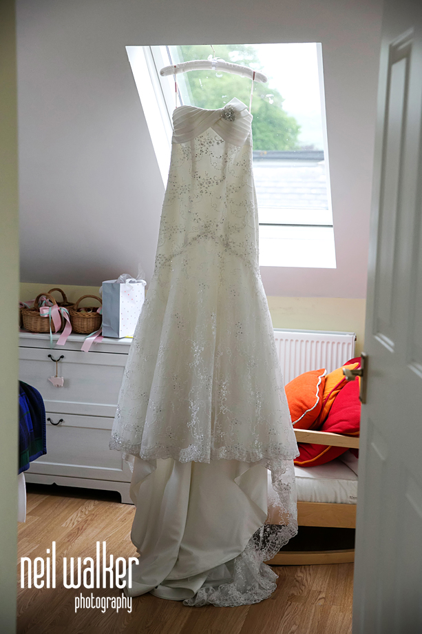 the bride's dress hanging up