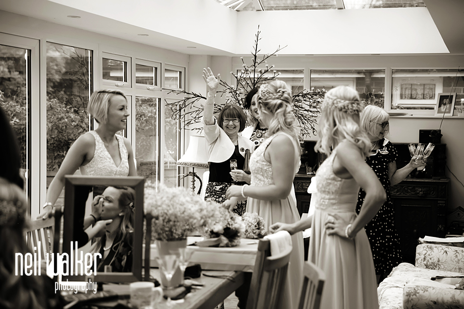 the bridesmaids talking by the makeup artist