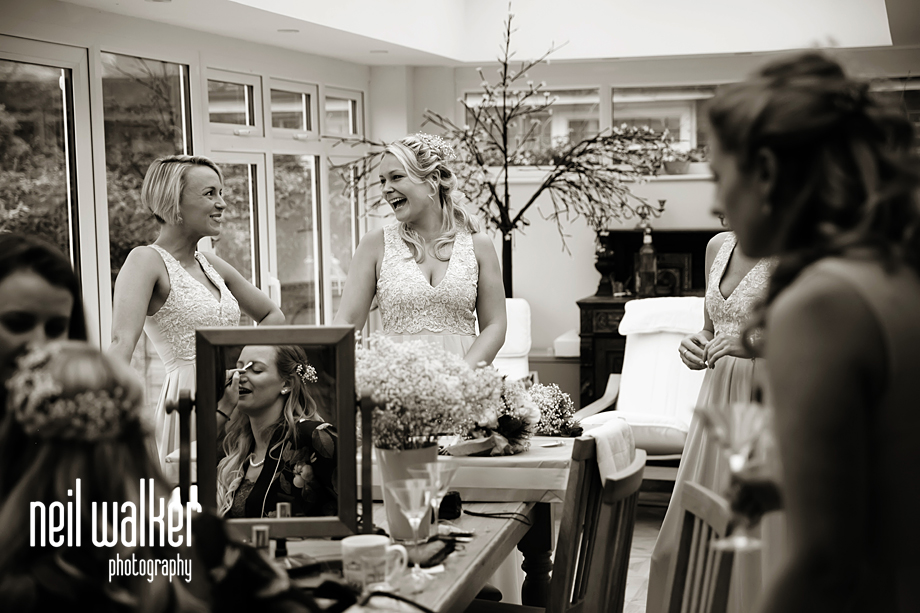 the bridesmaids laughing with the bride