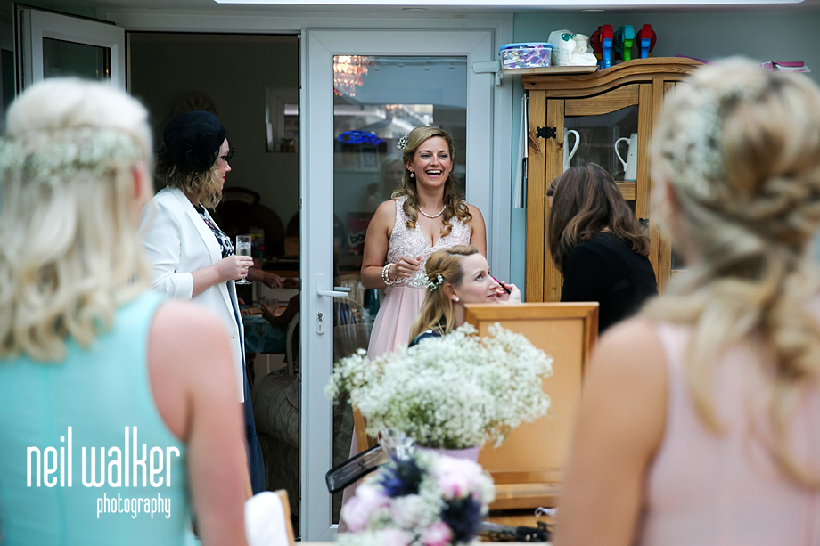 the bride's sister laughing