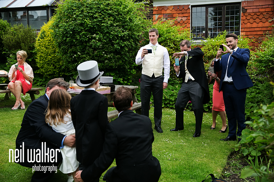 the groomsmen drinking in the pub garden