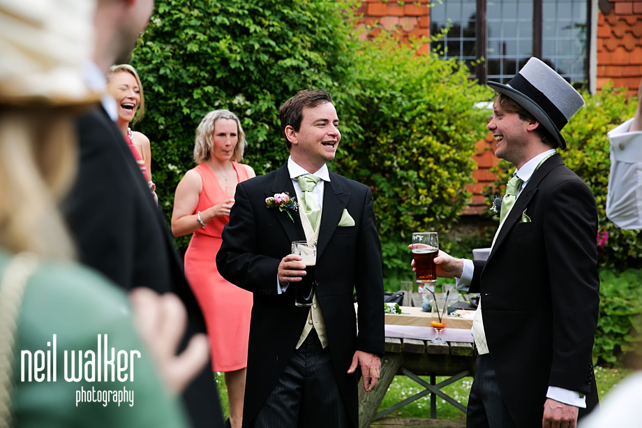 the groom chatting with guests