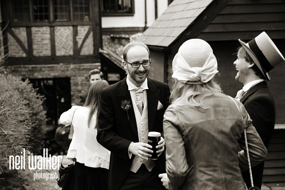 the best man talking to a guest