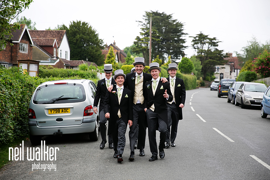 the groomsmen talking as they walk to the church