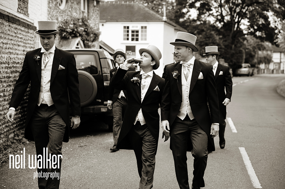 the groomsmen drinking on the way to the church