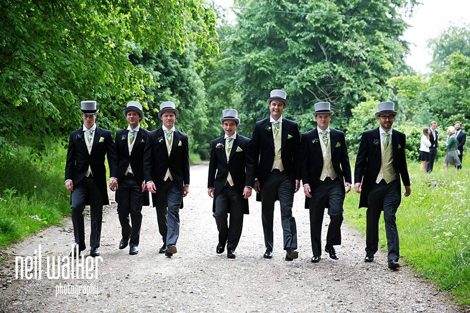 all the groomsmen walking towards the camera