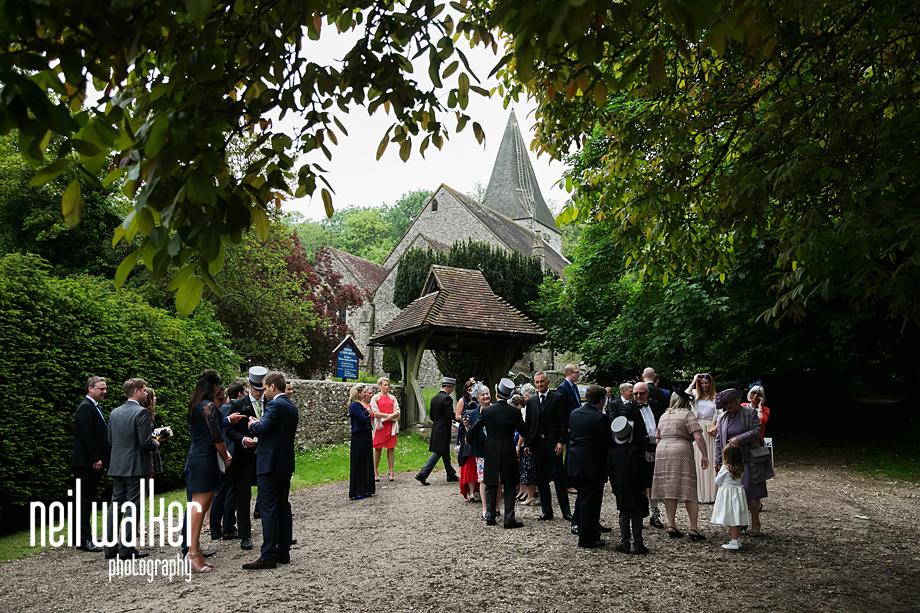 St John the Baptist Church with guests for the wedding