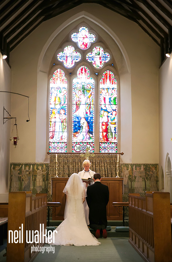 the bride & the groom at the alter