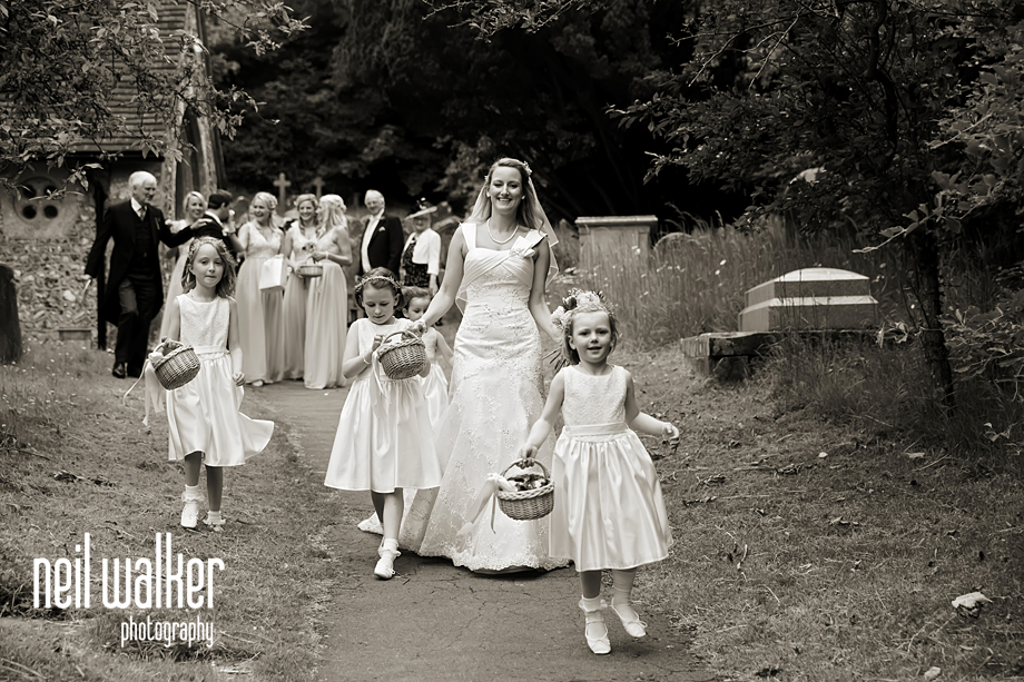 the bride walks away with little children around her