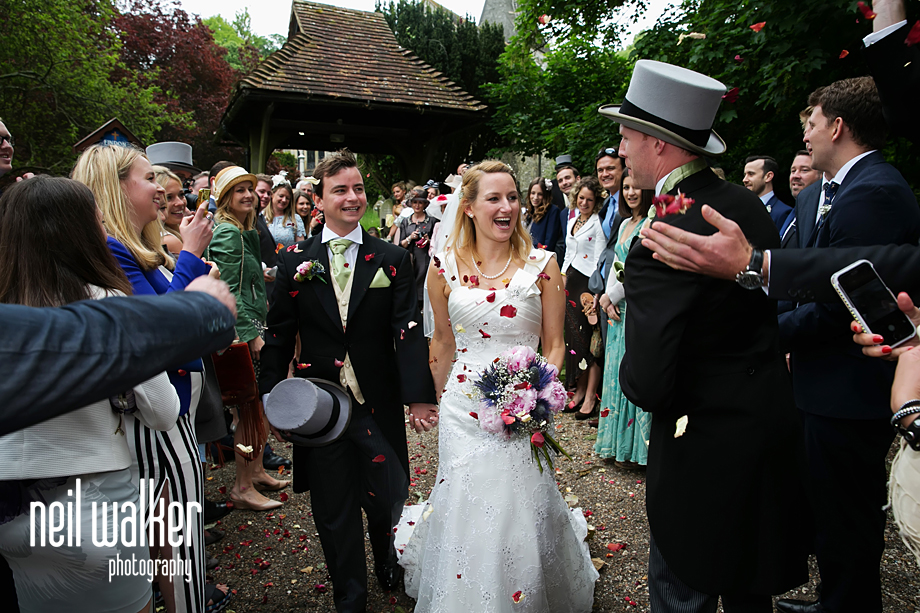 guests throwing confetti at the bride & groom