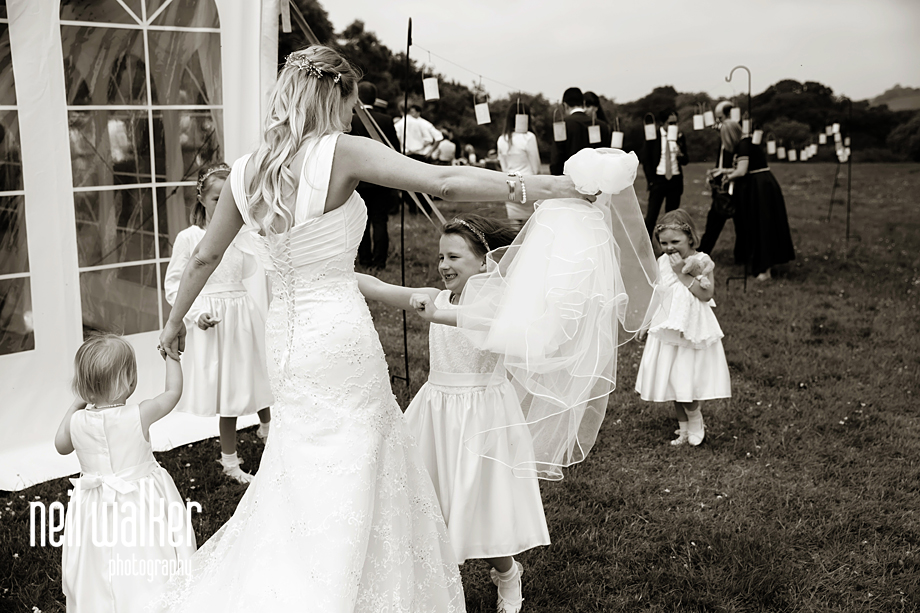 the bride hugging a flower girl