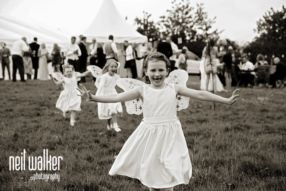 flower girls running with wings on