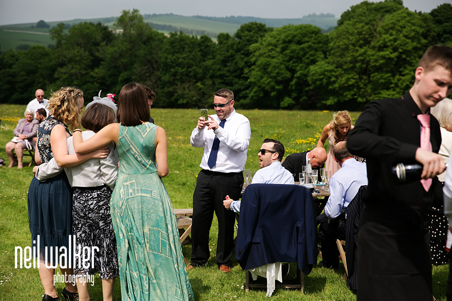 a wedding guest taking a photo