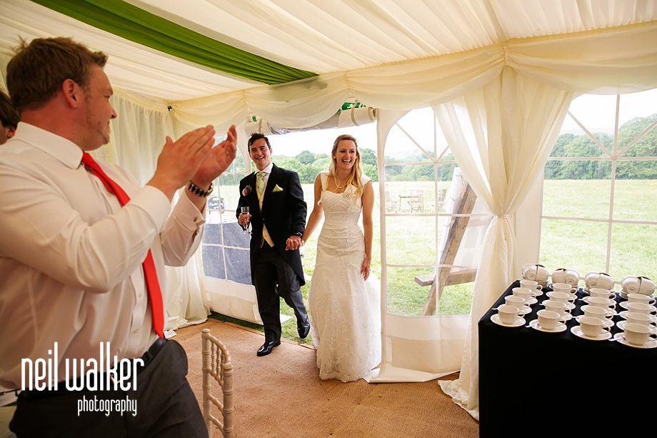 the couple enter the marquee