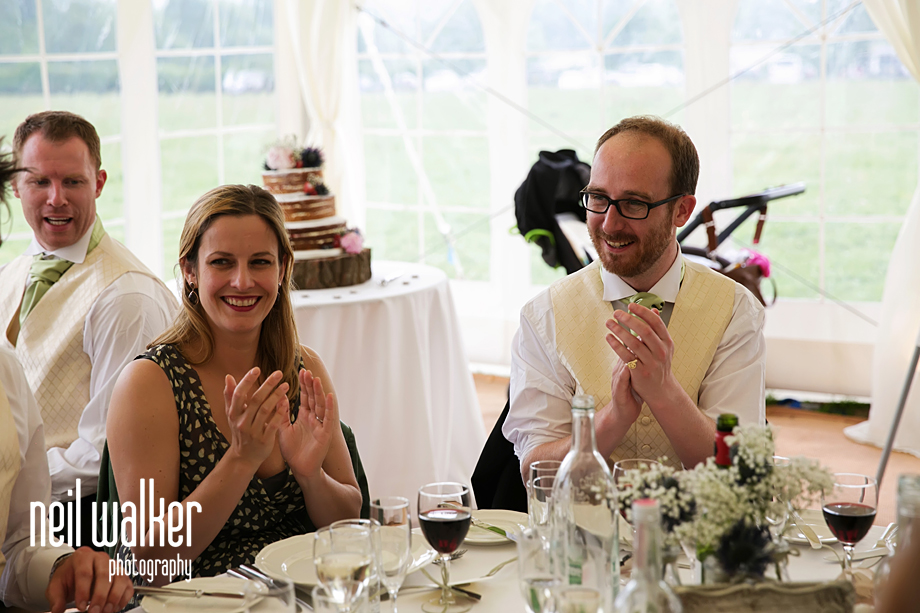 guests clapping the groom