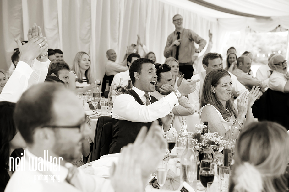 guests laughing at the speech