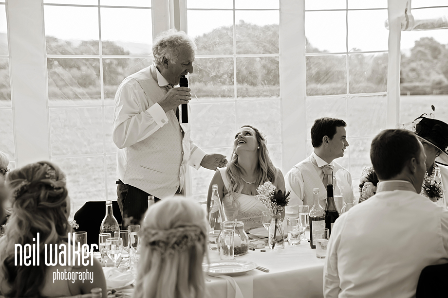 Father of the bride laughing