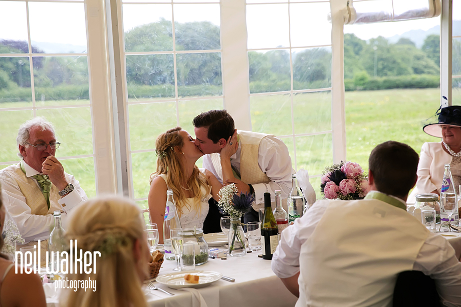 the groom kissing his wife