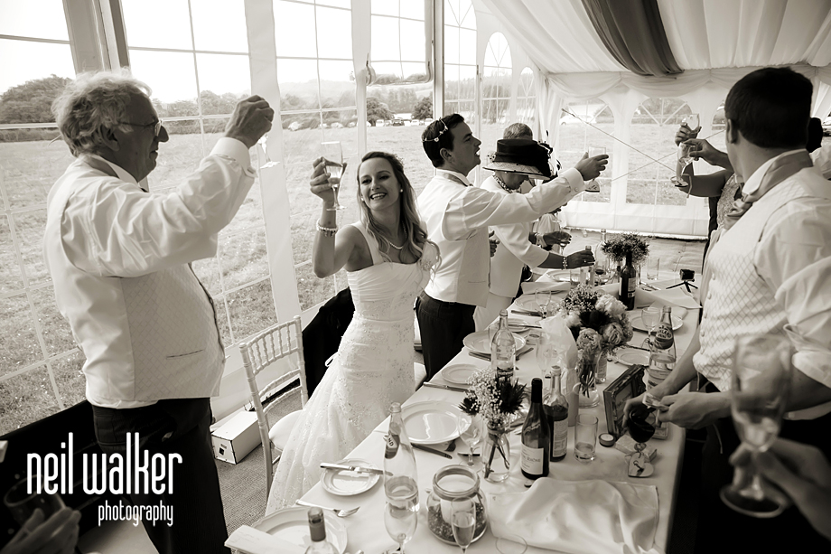 the bride raising her glass