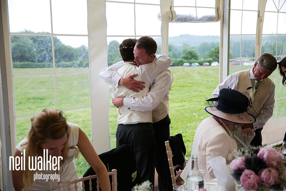 the groom & best man hugging