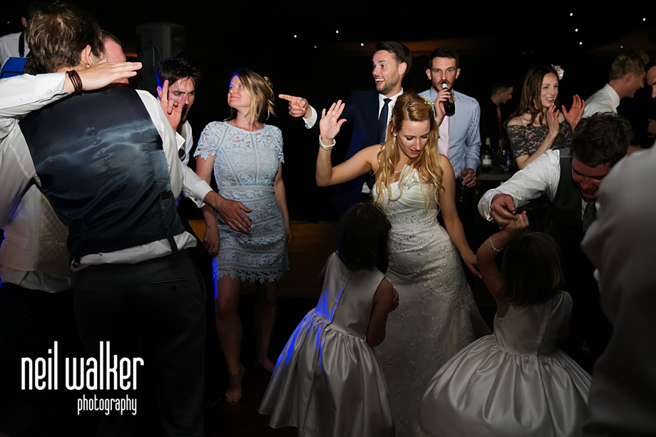 guests dancing with the bride