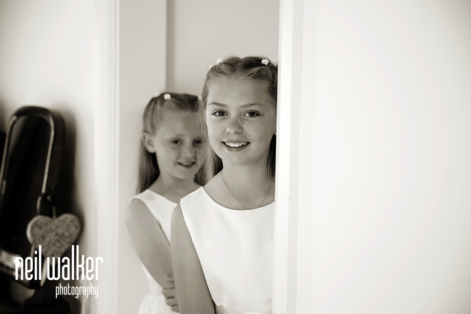 the flower girls looking out of the door