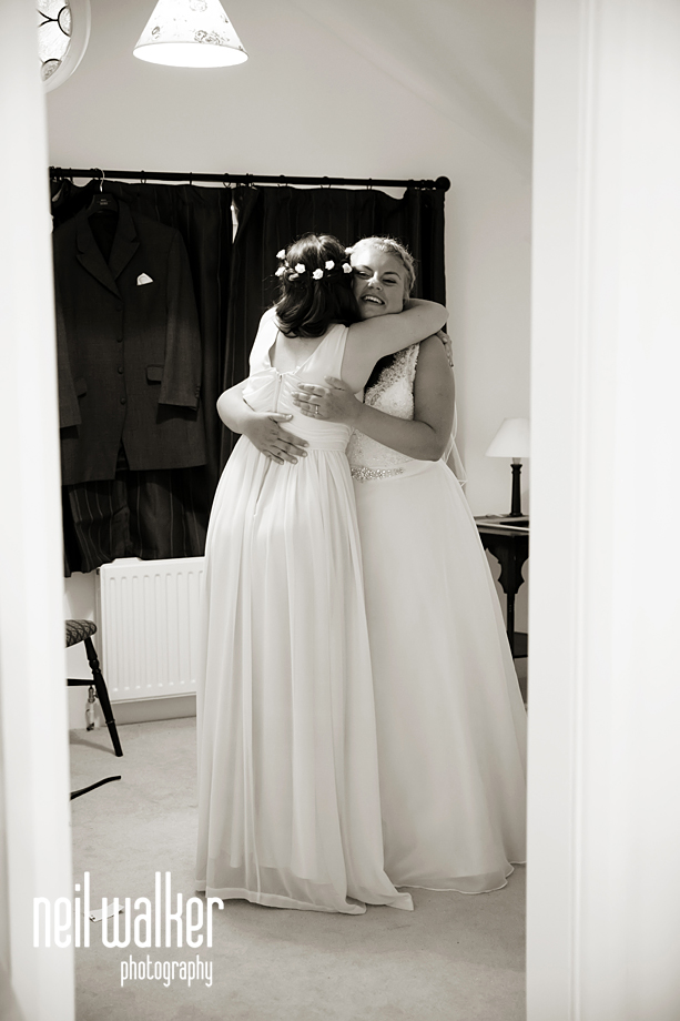 the bride & a bridesmaid hugging